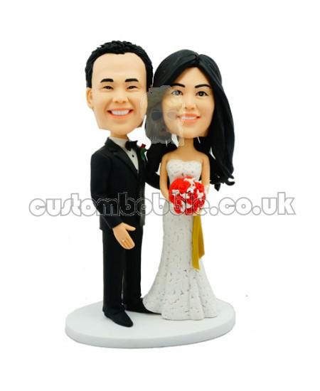 customised bobblehead wedding cake topper